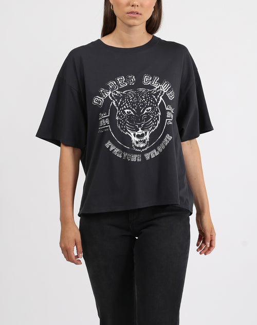 This is a photo of a model wearing the babes club leopard boxy crew neck tee in black by brunette the label.