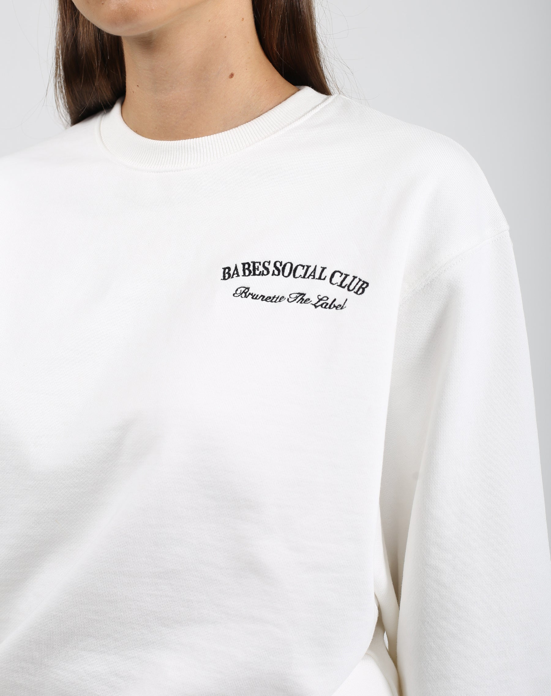 This is an image of the Babes Social Club Best Friend Crew Neck Sweater in Cream by Brunette the Label.