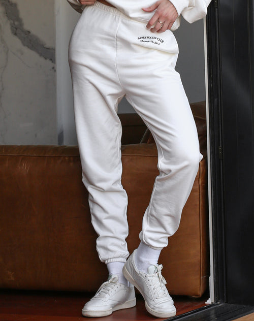 This is a photo of a model wearing the Babes Social Club Best Friend Jogger in Cream by Brunette the Label.