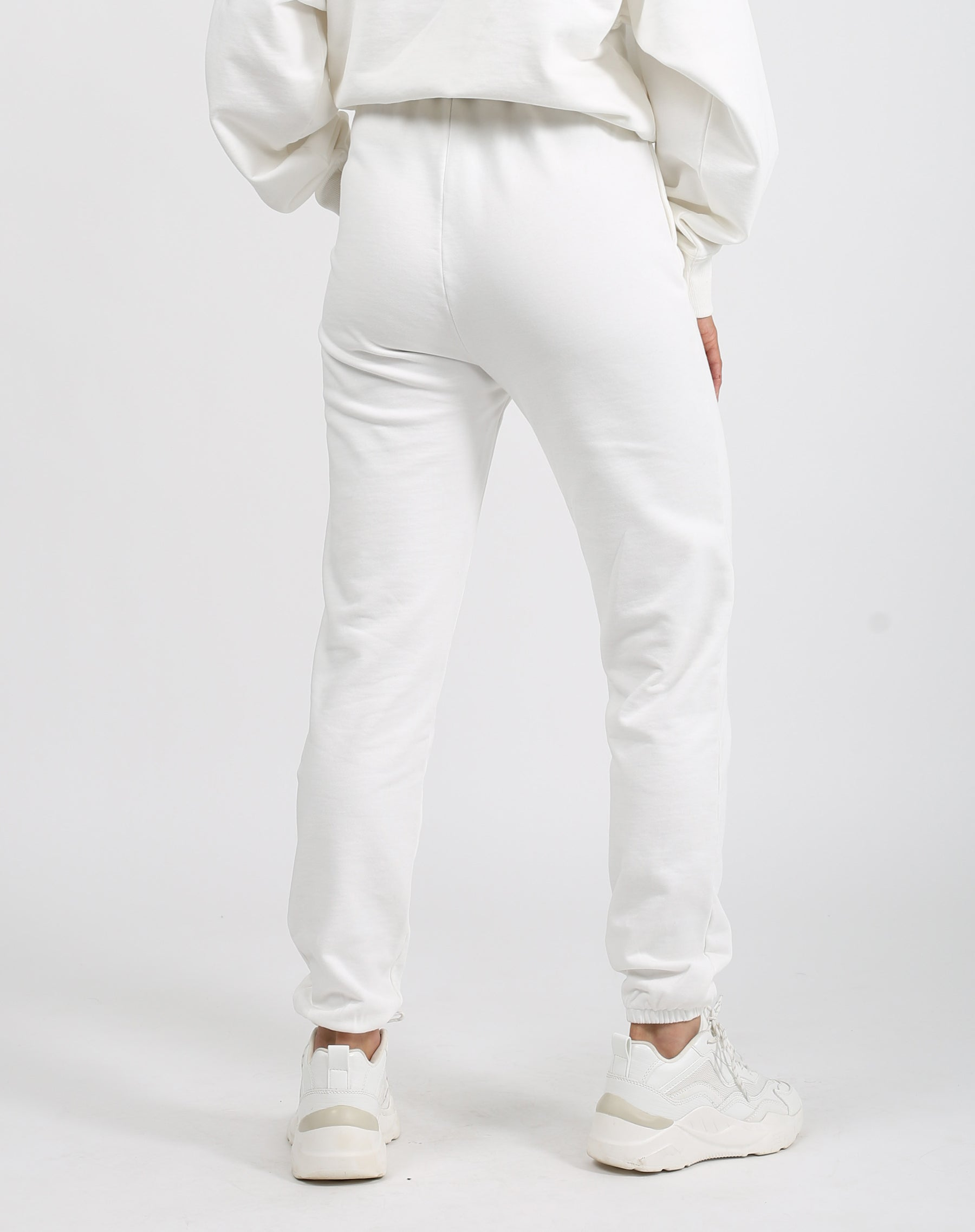 This is a photo of the back of a model wearing the Babes Social Club Best Friend Jogger in Cream by Brunette the Label.