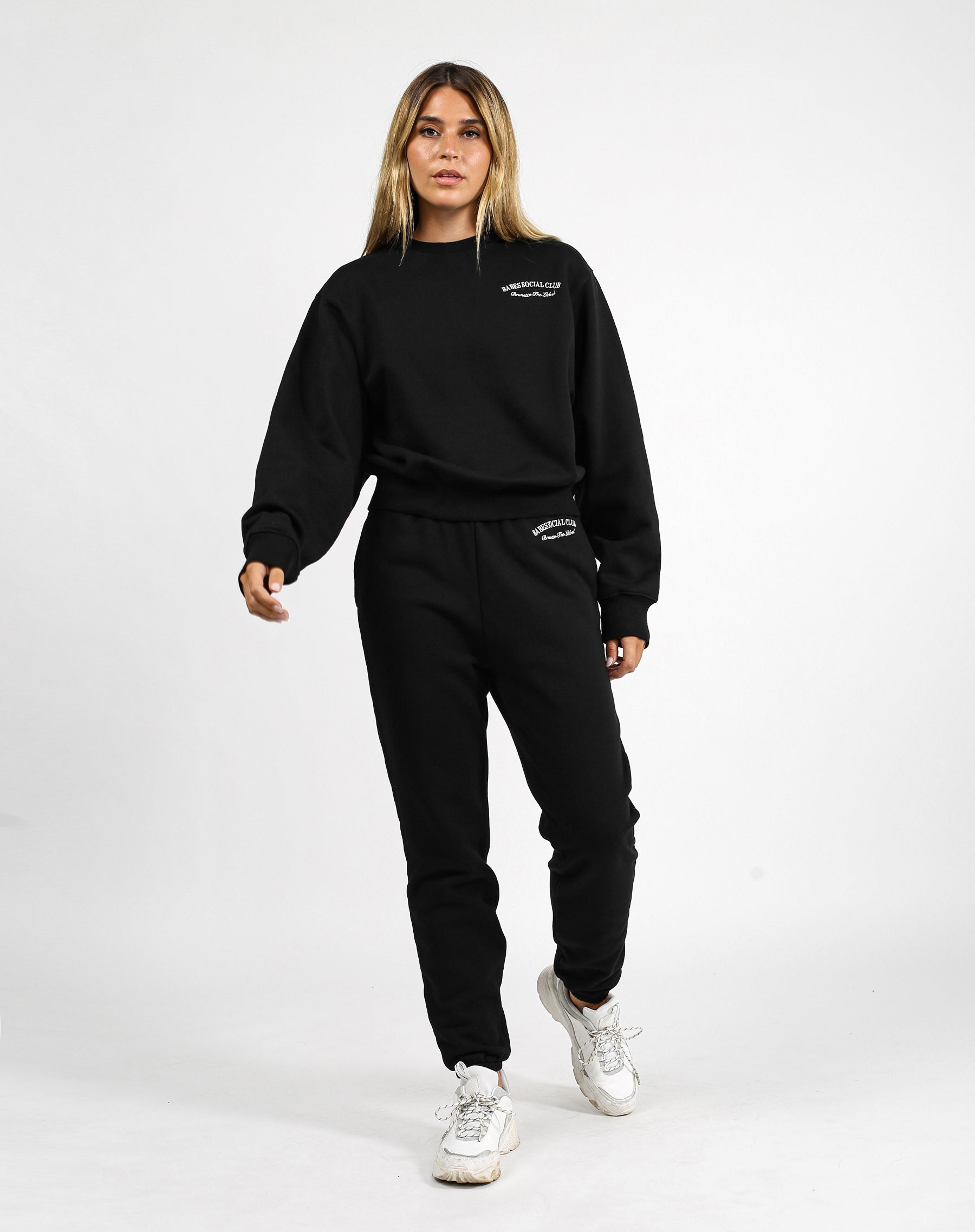 This is a photo of a model wearing the Babes Social Club Best Friend Jogger in Black by Brunette the Label.