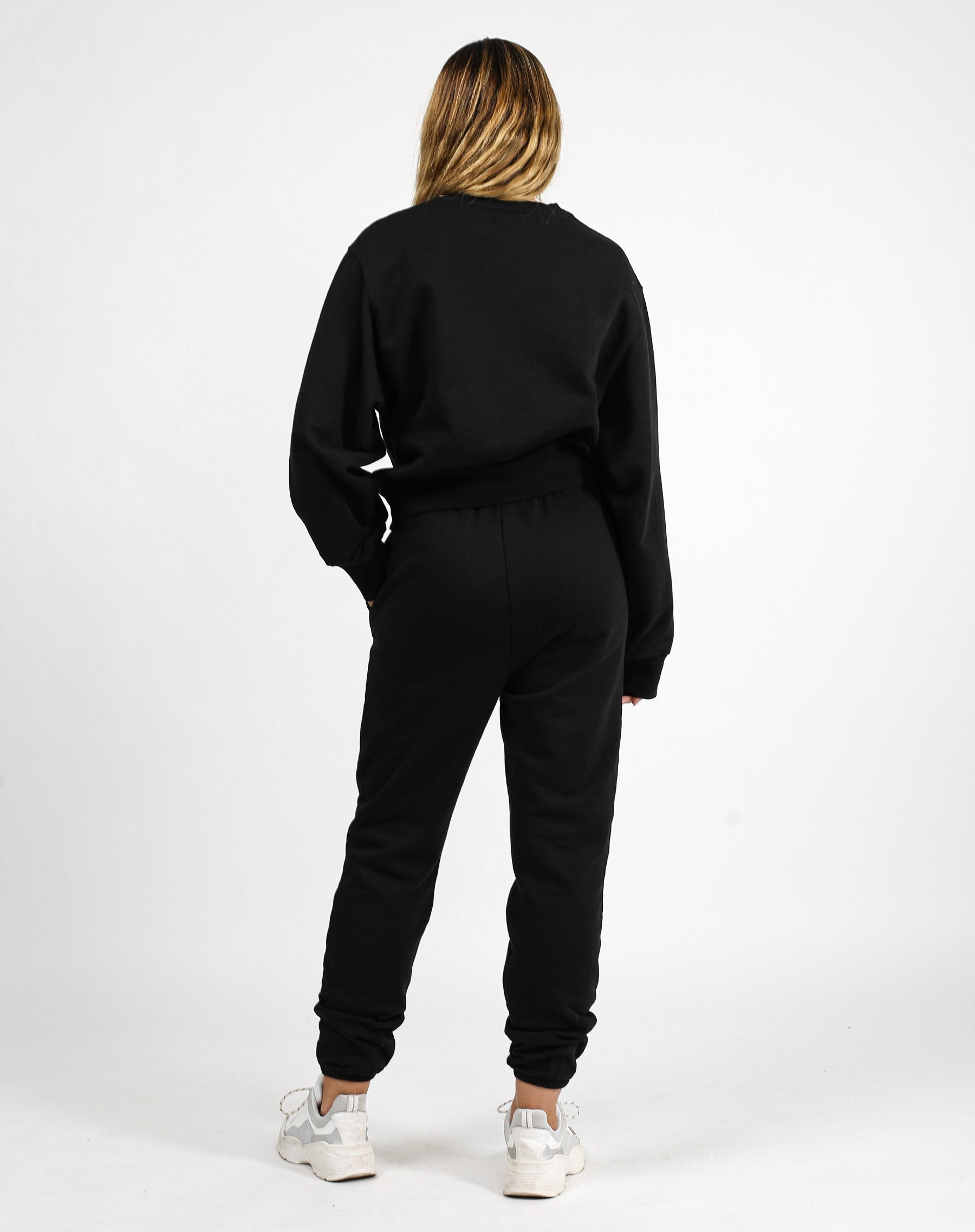 This is an image of the back of the Babes Social Club Best Friend Sweatsuit in Black by Brunette the Label.