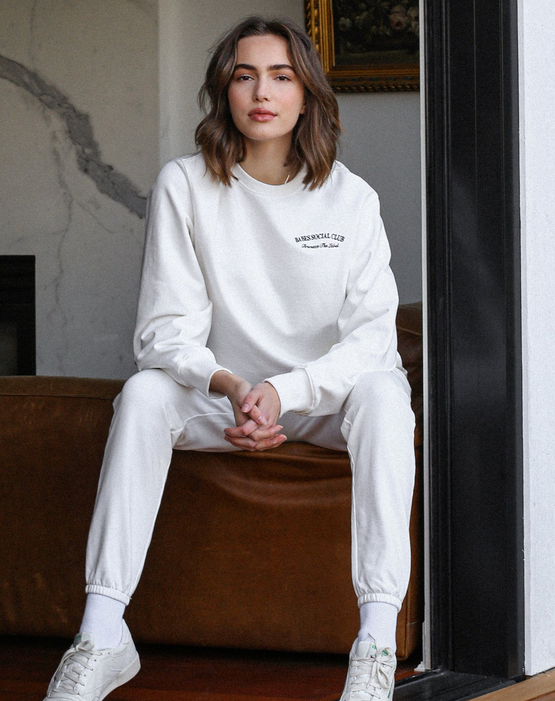 This is an image of the Babes Social Club Best Friend Crew Neck Sweater in Cream by Brunette the Label..