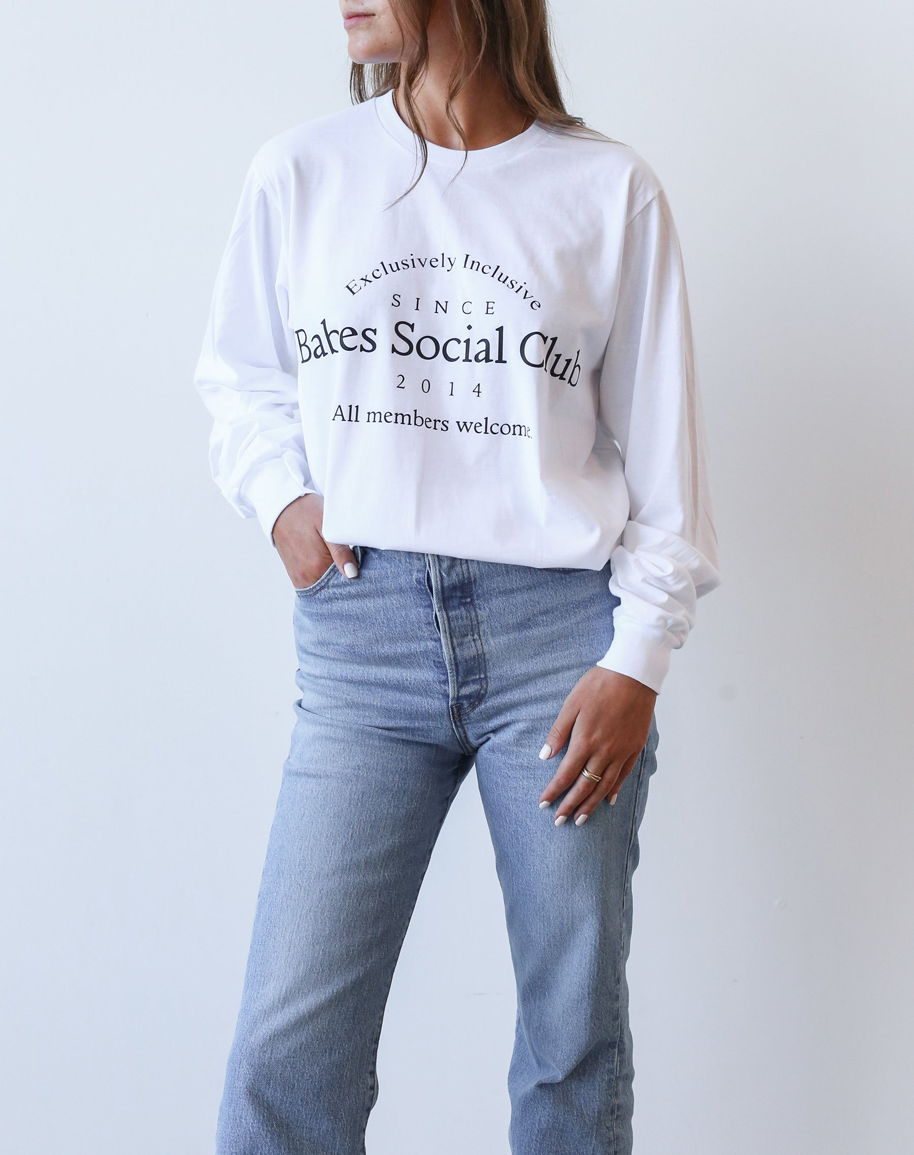 This is an Ecommerce photo of the Babes Social Club Long Sleeve Tee in white and black by Brunette the Label.