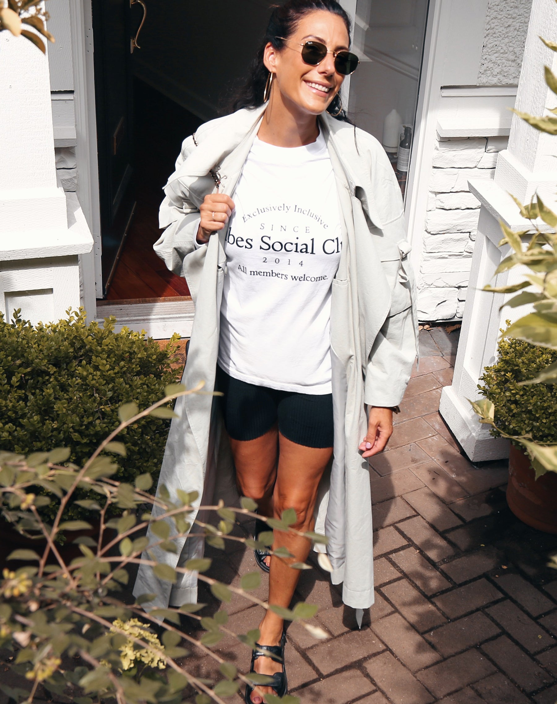 This is a photo of the Babes Social Club Long Sleeve Tee in white and black by Brunette the Label.