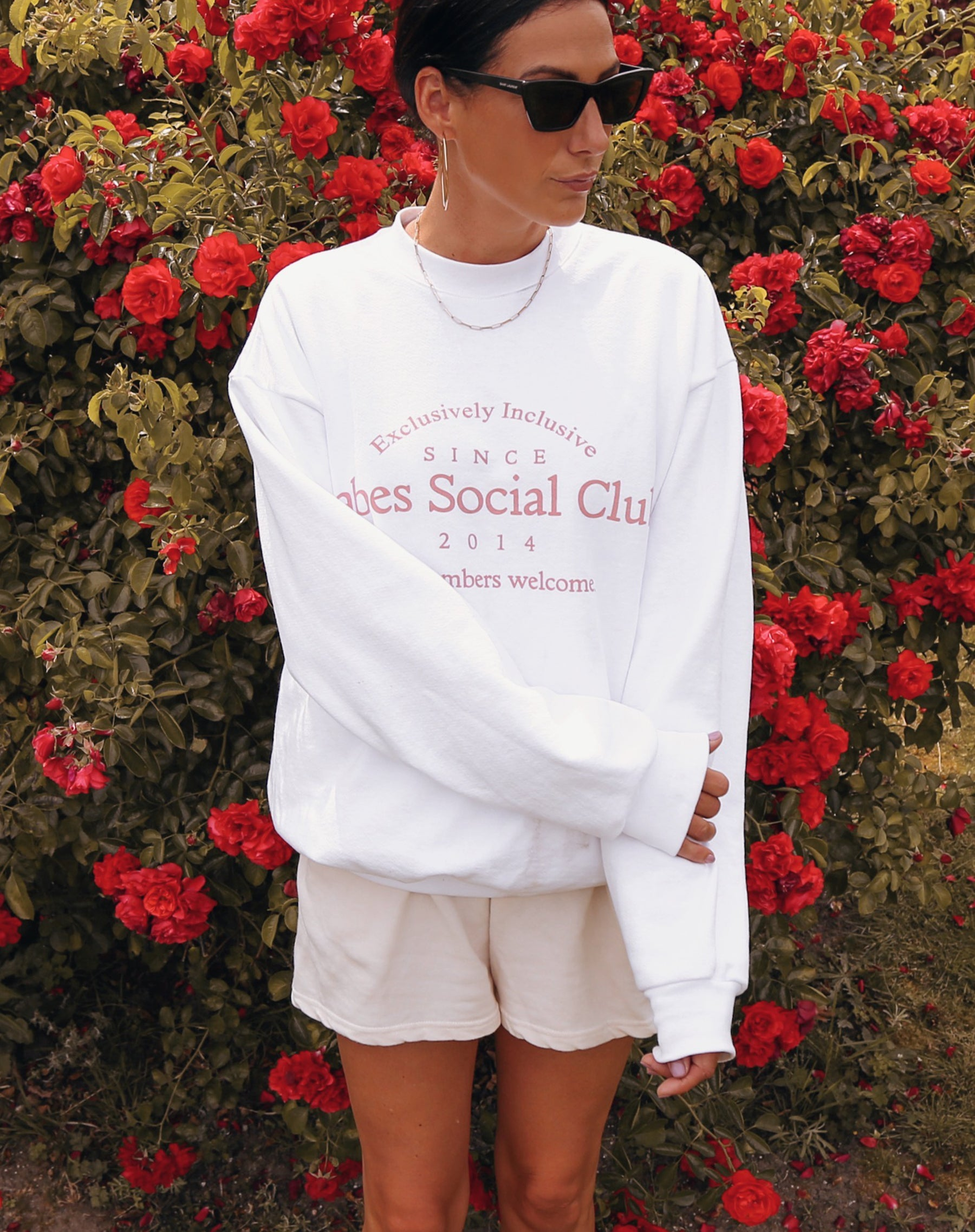This is a photo of the Babes Social Club Crew Neck Sweatshirt in white and pink by Brunette the Label.