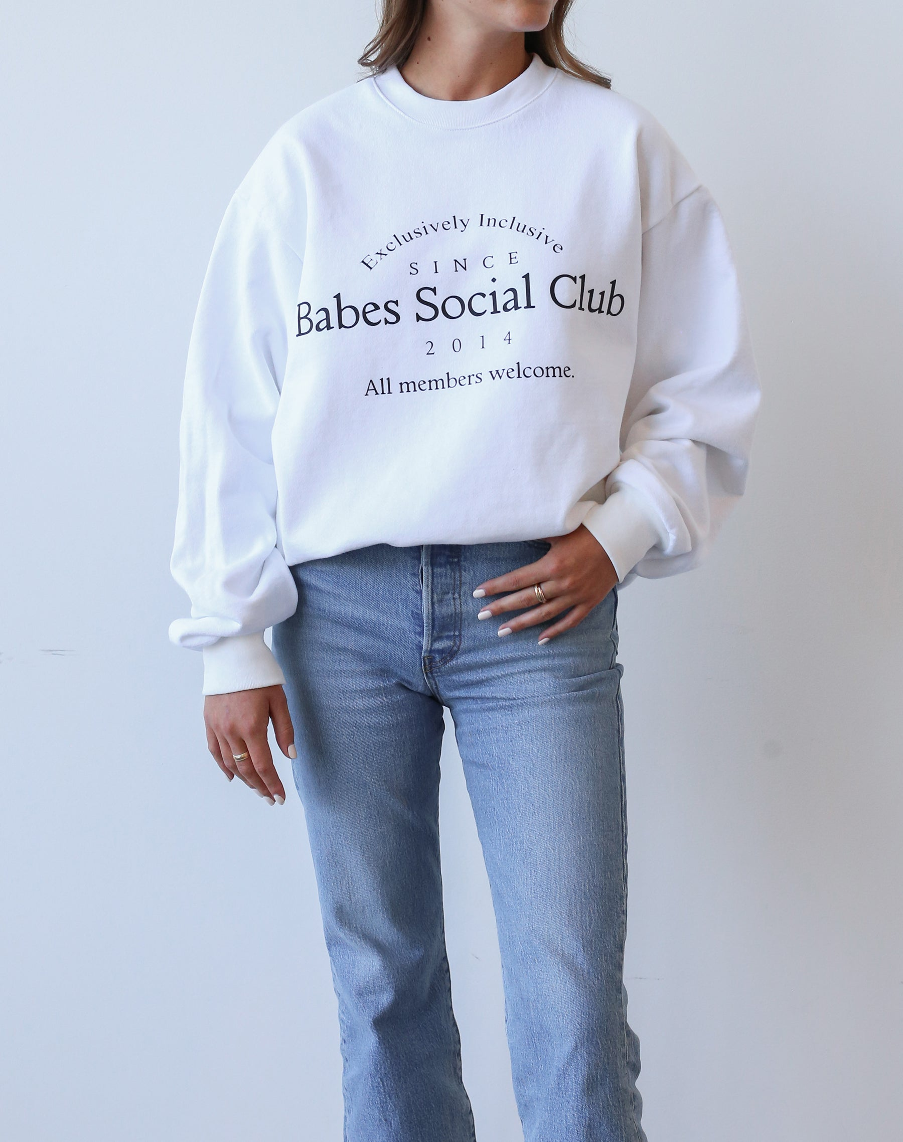 This is an Ecommerce photo of the Babes Social Club Crew Neck Sweatshirt in white and black by Brunette the Label.