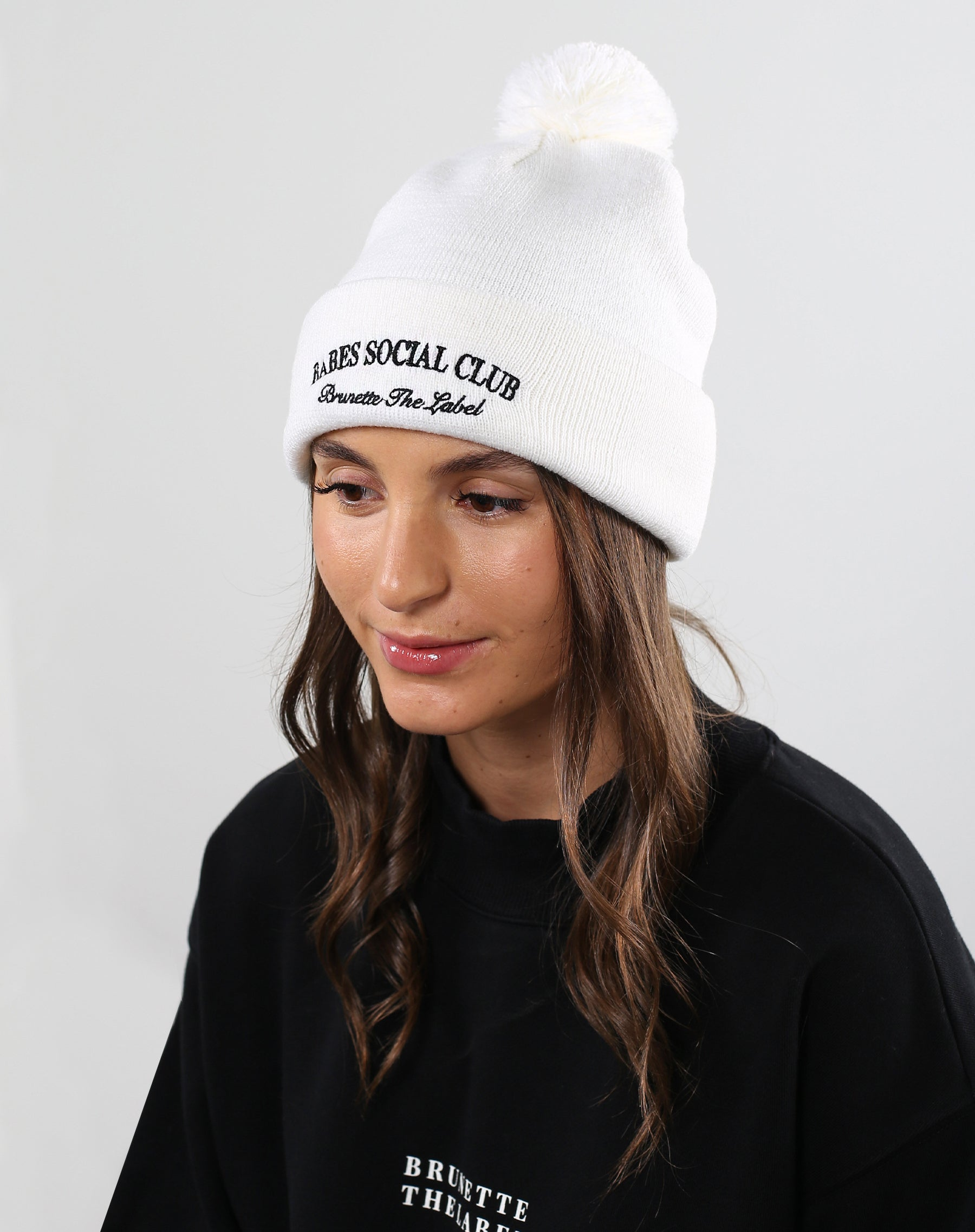 This is a photo of a model wearing the Babes Social Club Toque in Cream by Brunette the Label.