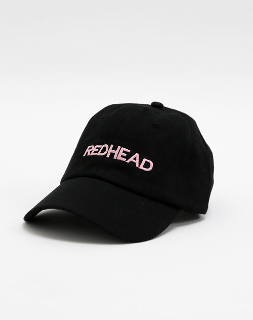 Photo of the Redhead baseball cap in black and soft champagne pink by Brunette the Label.