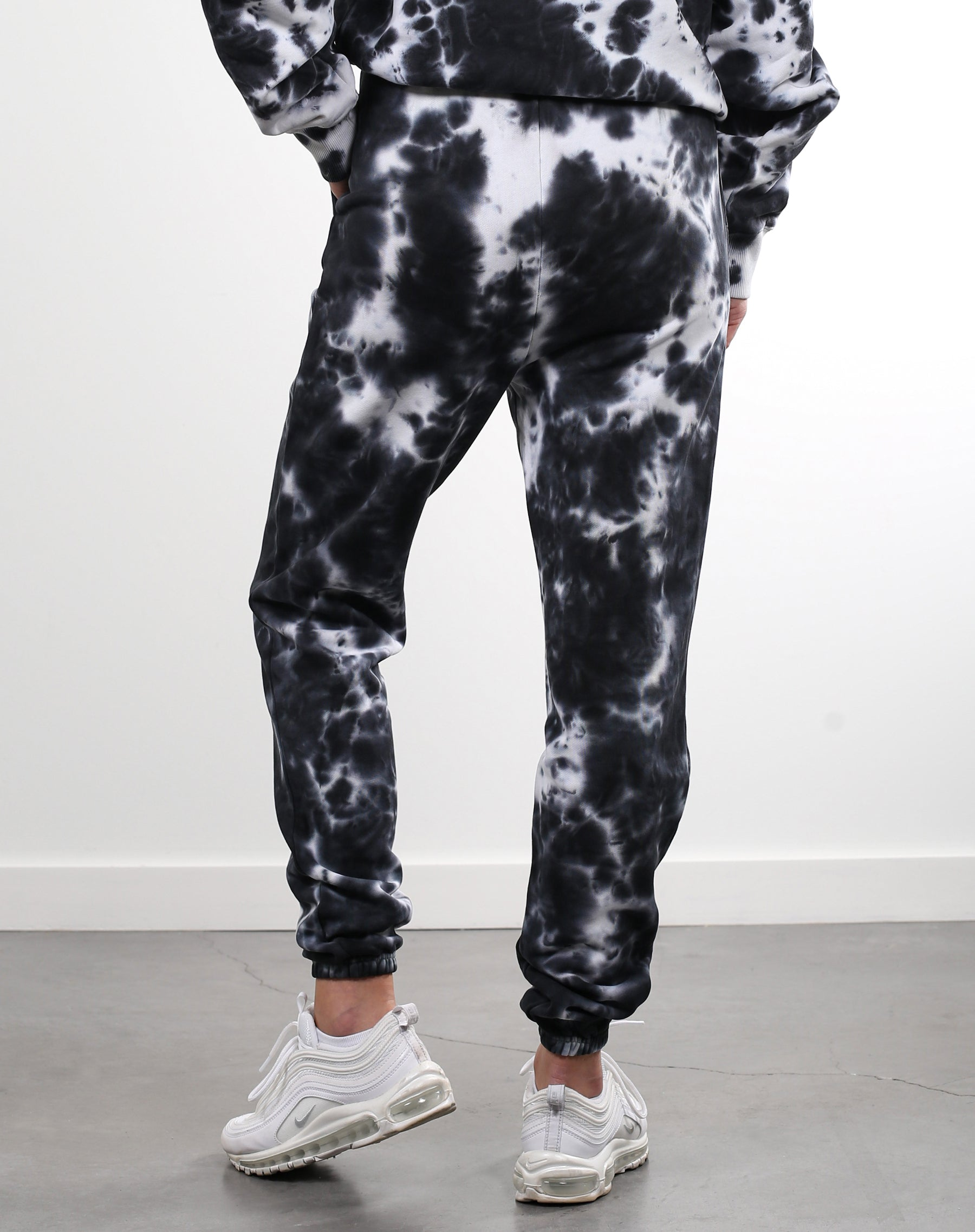 This is a photo of a model wearing the Best Friend Jogger in Black Marble Dye by Brunette the Label.