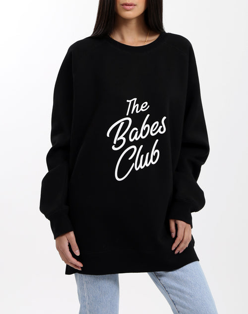 Photo of the Babes Club big sister crew neck sweater in black by Brunette the Label.