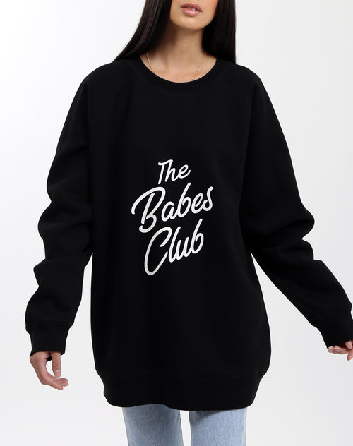 Photo 2 of the Babes Club big sister crew neck sweater in black by Brunette the Label.