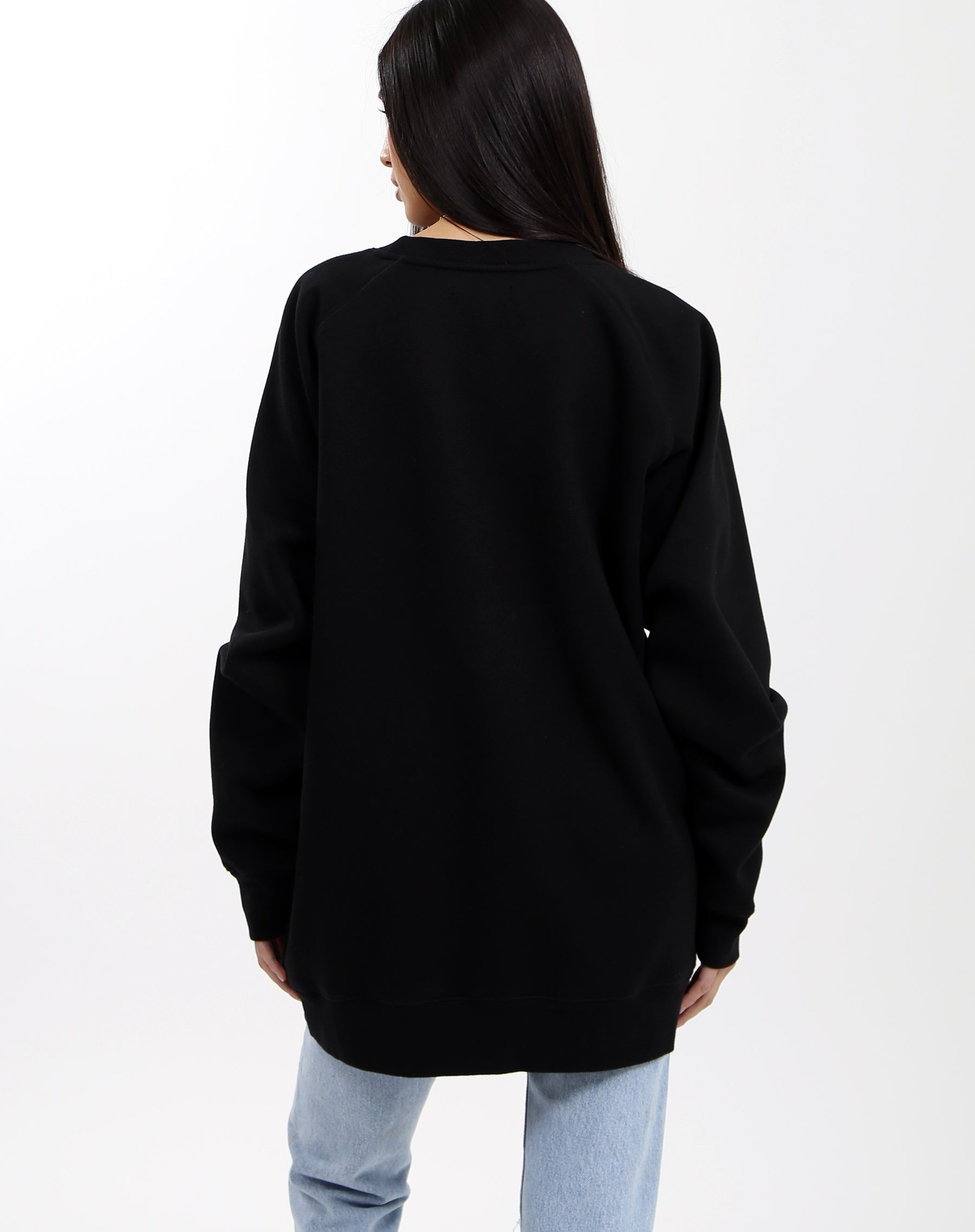 Photo of the back of the Babes Club big sister crew neck sweater in black by Brunette the Label.