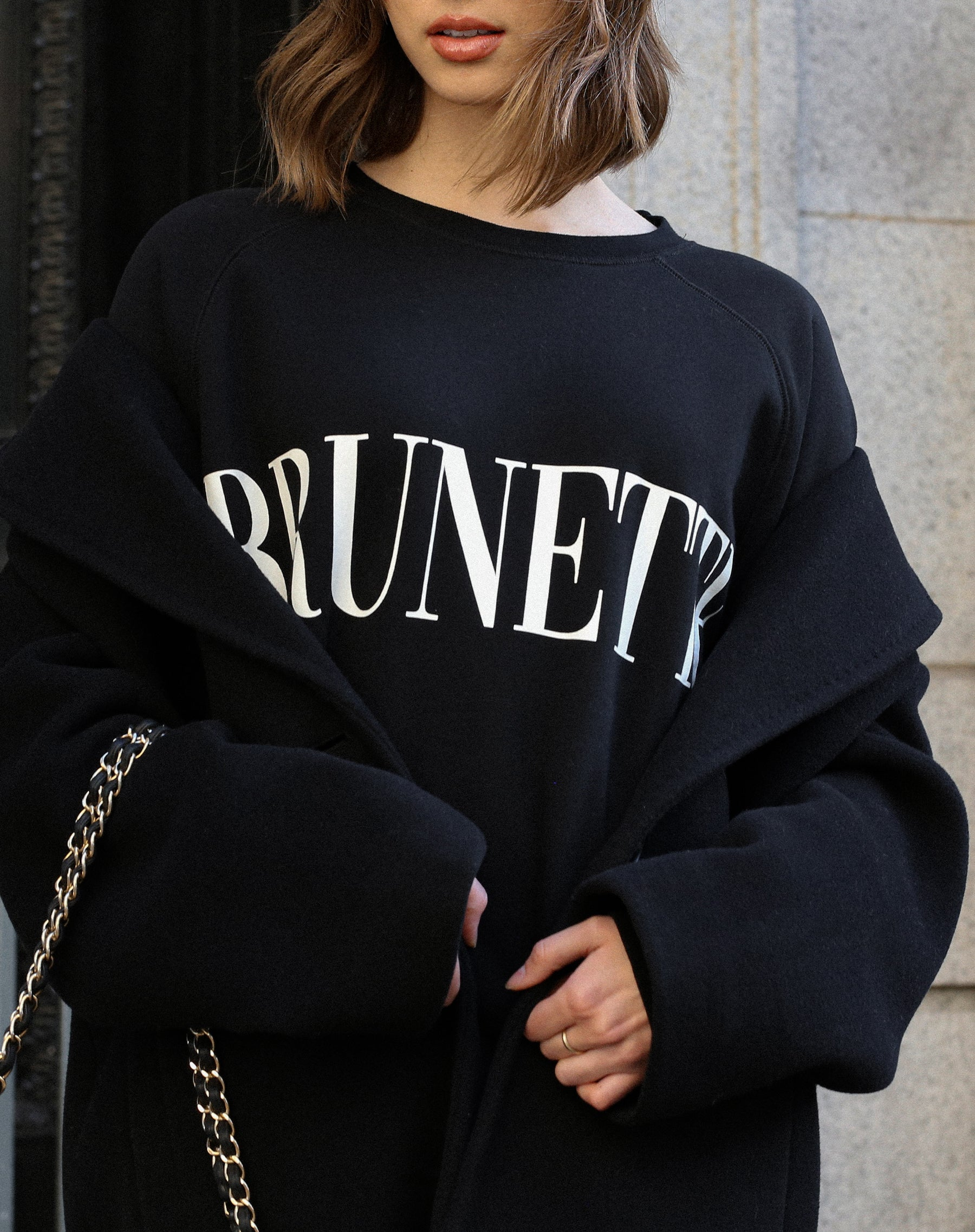 This is a photo of a model wearing the Lounge Brunette Big Sister Crew Neck Sweatshirt in Black by Brunette the Label.