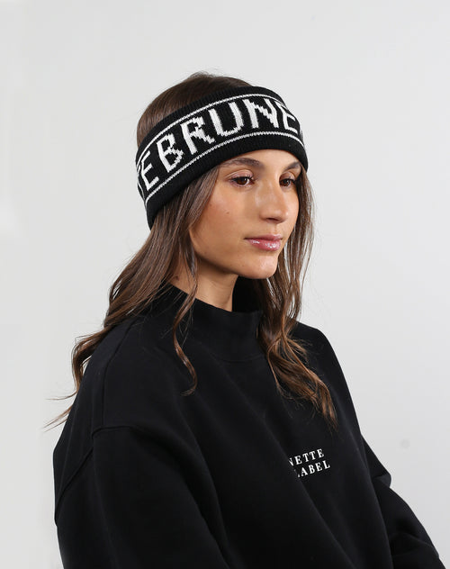 This is a photo of a model wearing the Brunette Head band in Black by Brunette the Label.