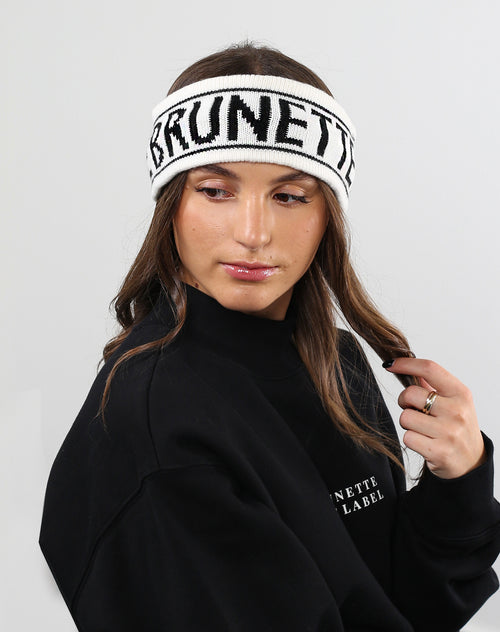 This is a photo of a model wearing the Brunette Head band in Cream by Brunette the Label.