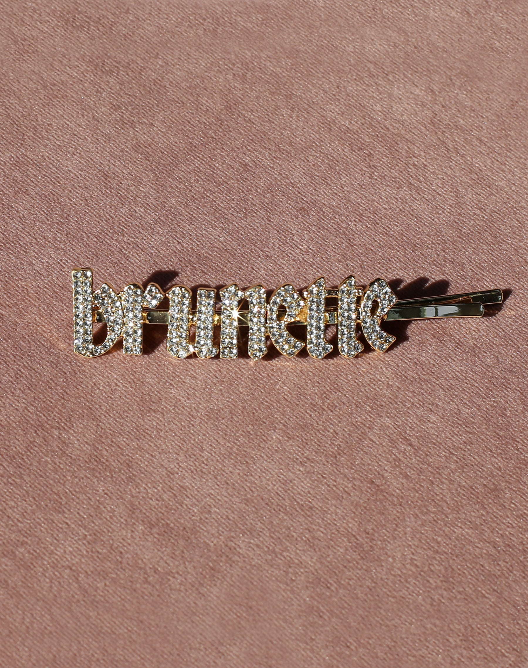 This is a photo of the Brunette Rhinestone Hair Clip in Gold by Brunette the Label.