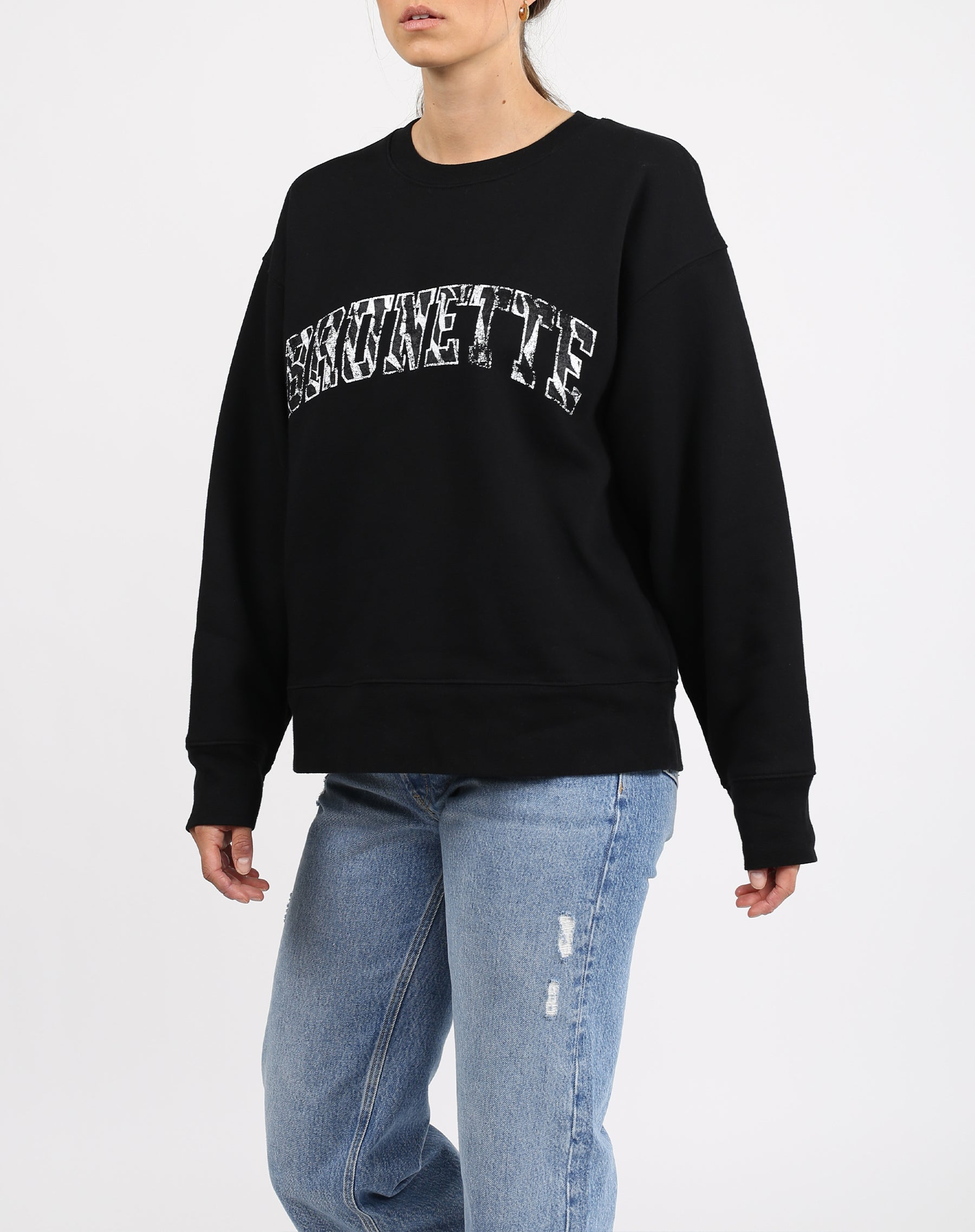 This is an image a model wearing the Brunette Zebra Varsity Step Sister Crew Neck Sweatshirt in Black by Brunette the Label.