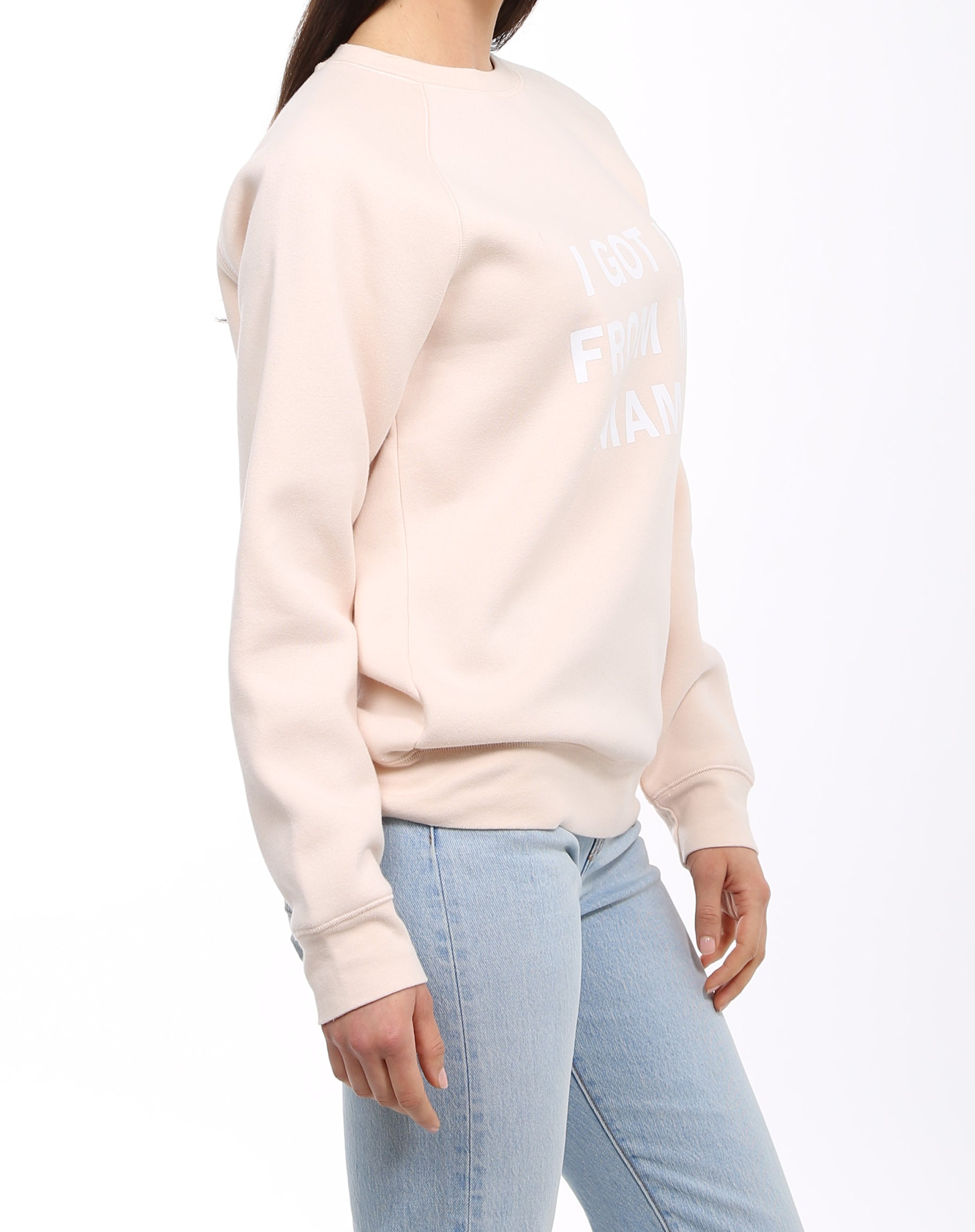 Side photo of the I Got it From My Mama classic crew neck sweatshirt in peach crush by Brunette the Label.