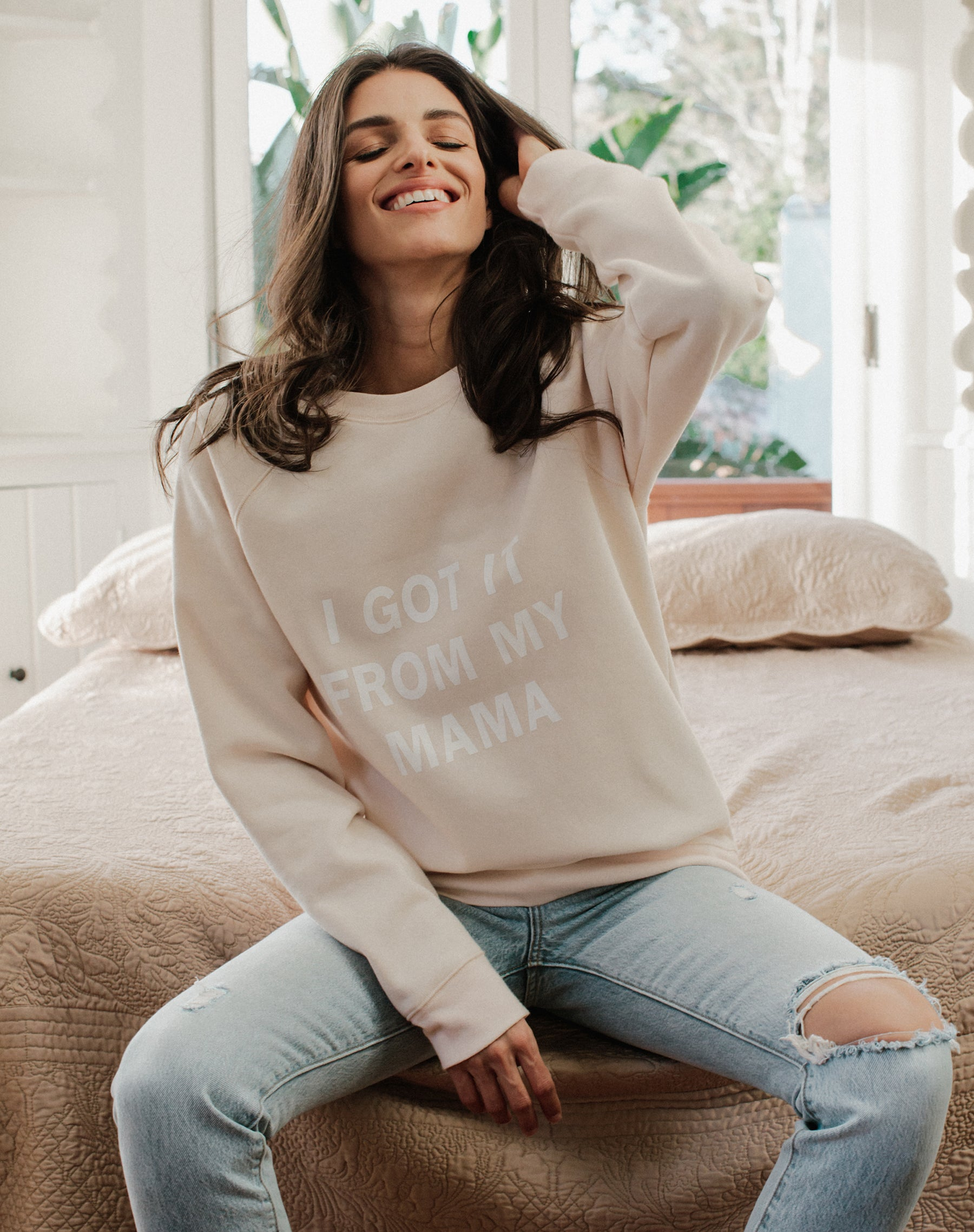 Photo of the I Got it From My Mama classic crew neck sweatshirt in peach crush by Brunette the Label.