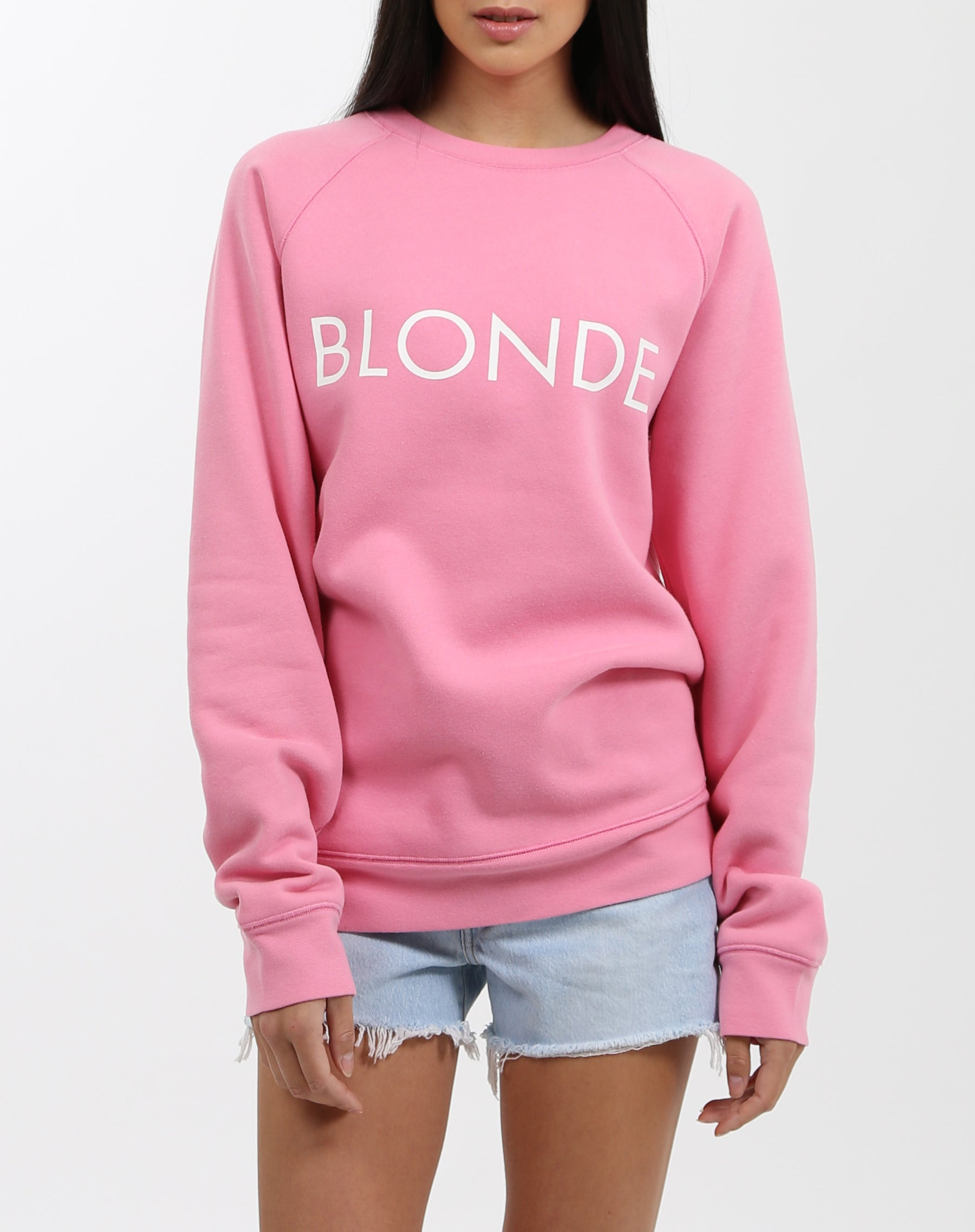 Photo of the Blonde classic crew neck sweatshirt in hot pink by Brunette the Label.
