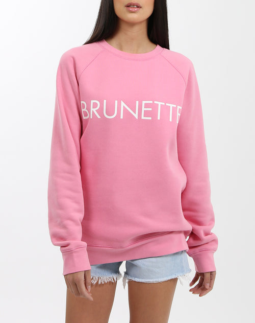Photo of the Brunette classic crew neck sweatshirt in hot pink by Brunette the label.