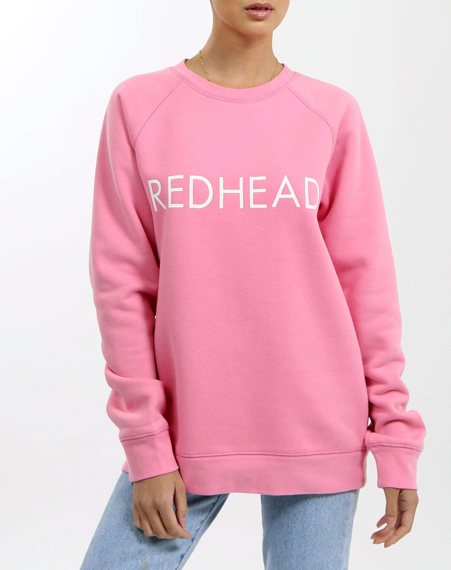 Photo of the Redhead classic crew neck sweatshirt in hot pink by Brunette the Label.