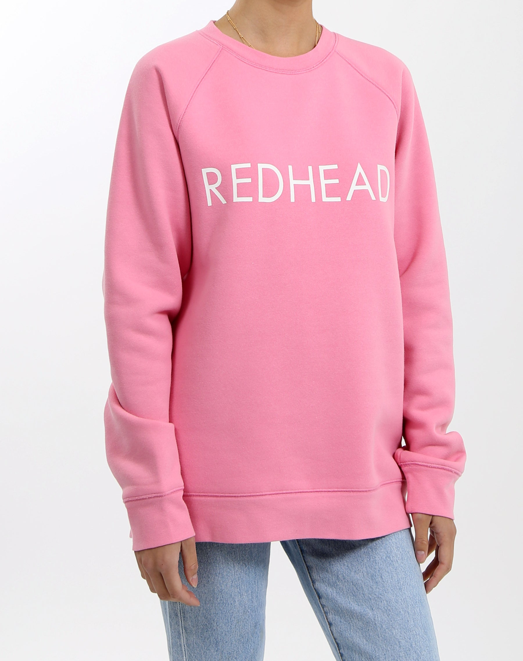 Photo 2 of the Redhead classic crew neck sweatshirt in hot pink by Brunette the Label.