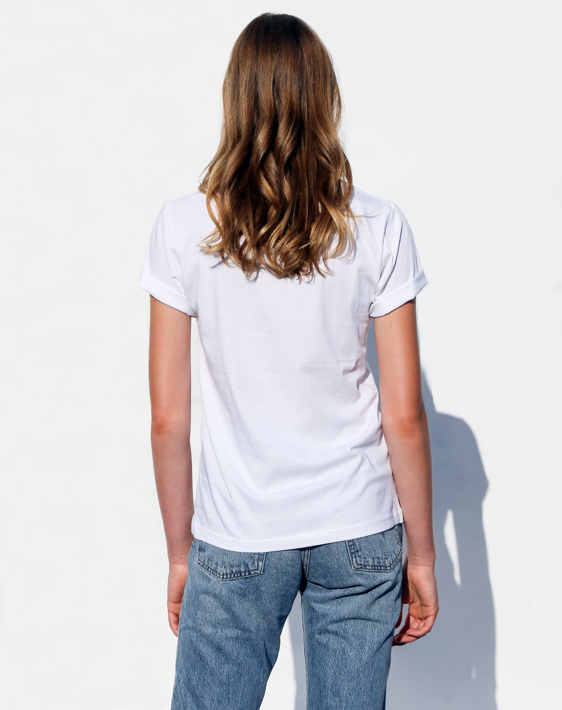 Photo of the back of the Proud to be Canadian classic crew neck tee in white from the Canada Day collection by Brunette the Label.