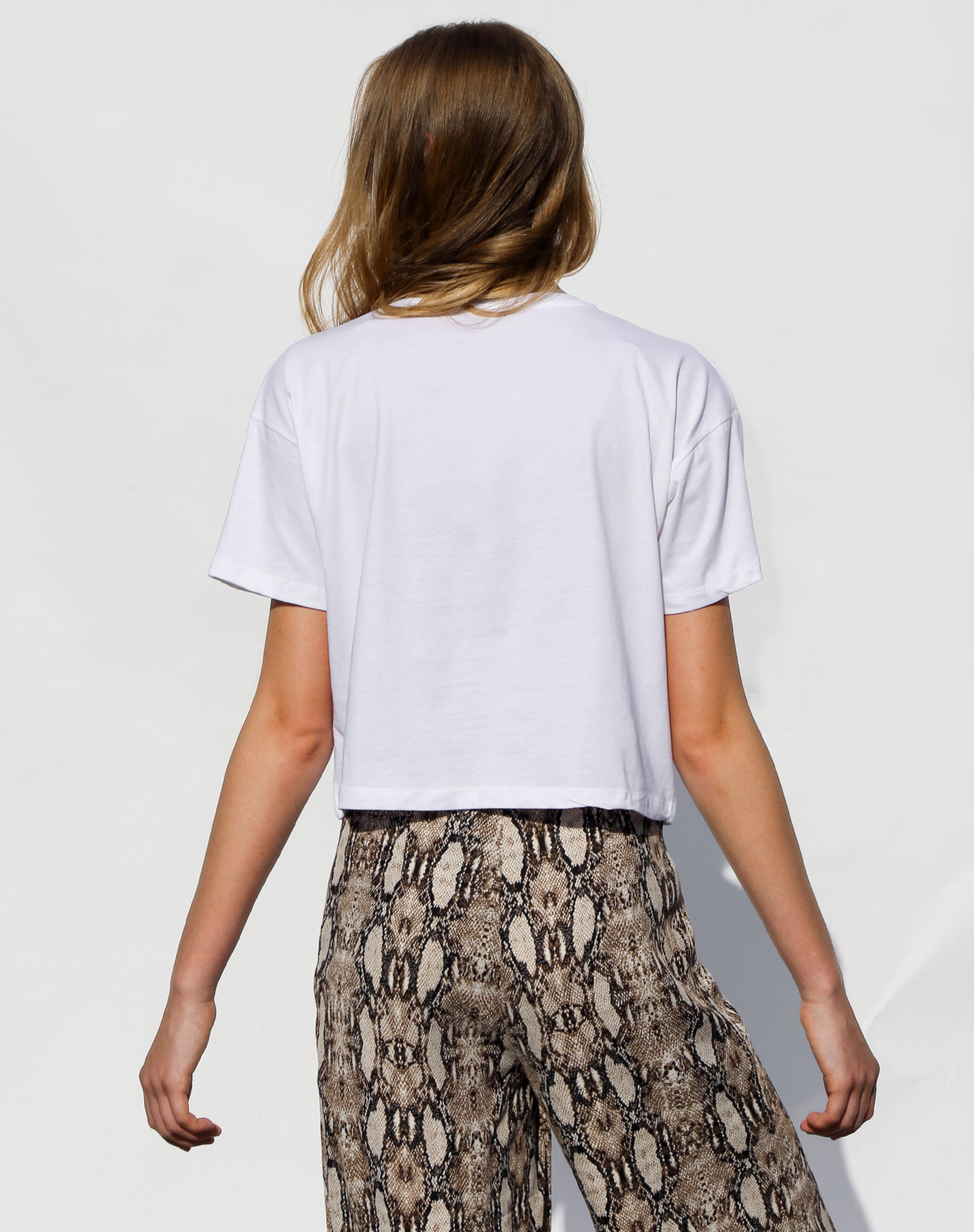 Photo of the back of the Nice cropped white tee from the Canada Day collection by Brunette the Label.