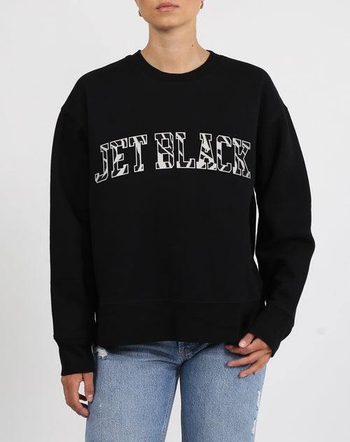 This is an image a model wearing the Jet Black Zebra Varsity Step Sister Crew Neck Sweatshirt in Black by Brunette the Label.