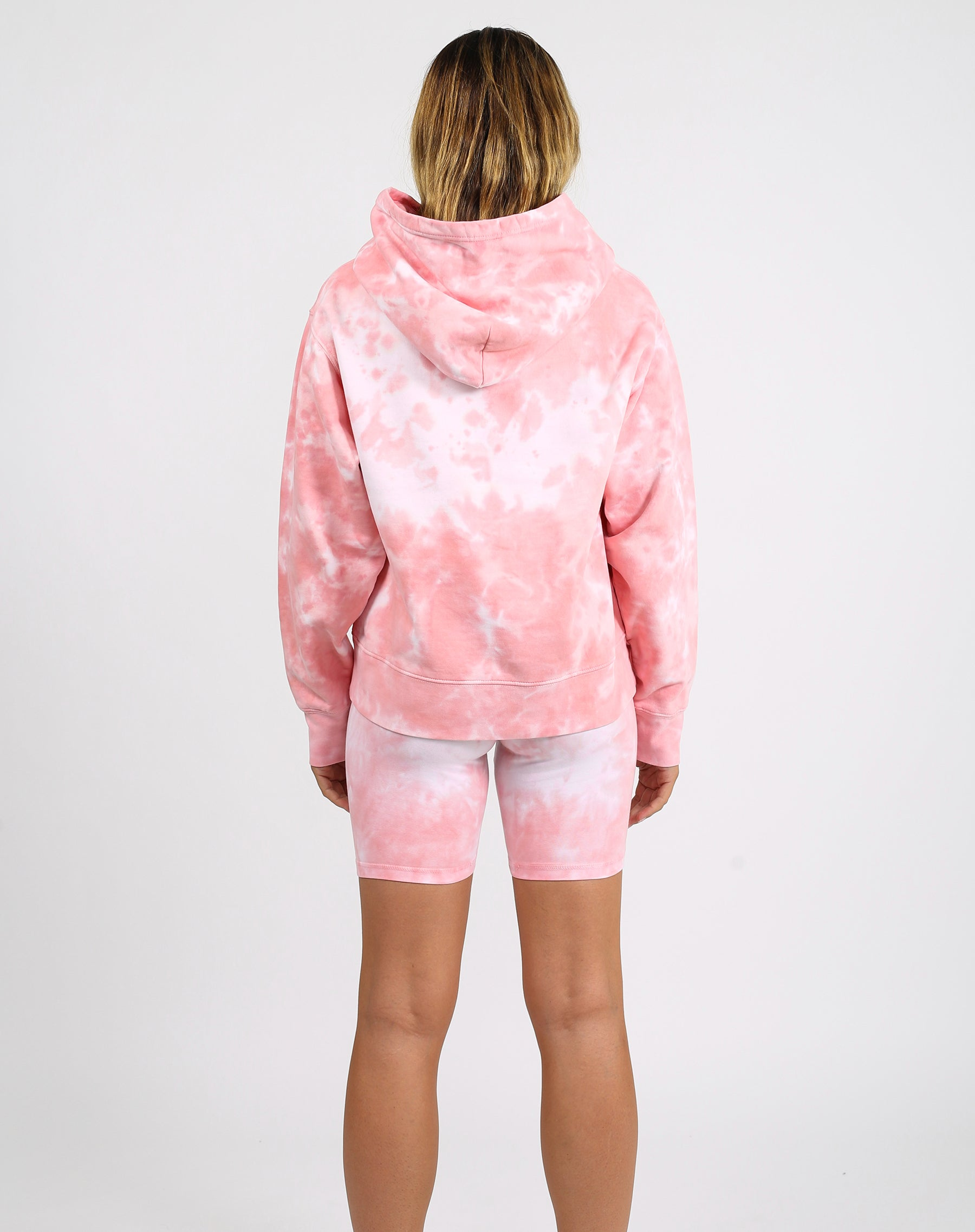 This is a photo of a model wearing the babes supporting babes step sister hoodie in pink marble by Brunette the Label x Juicy Couture.
