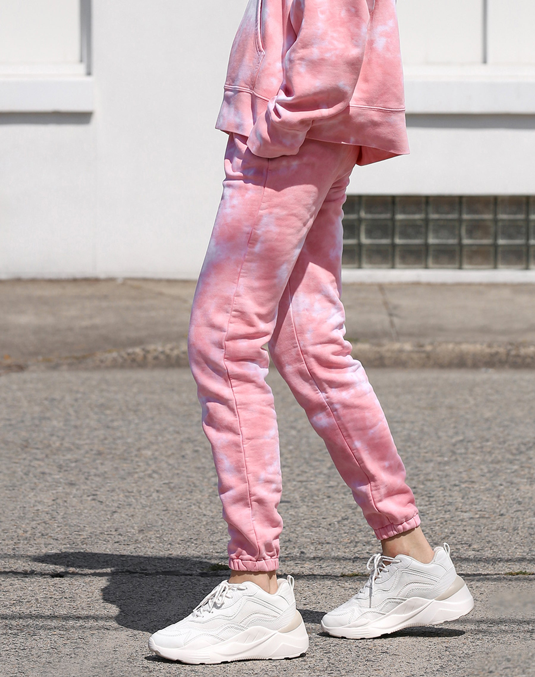 This is a photo of a model wearing the best friend jogger  in pink marble by Brunette the Label x Juicy Couture.