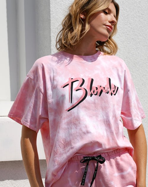 This is a photo of a model wearing the blonde boxy retro tree in pink marble by Brunette the Label x Juicy Couture.