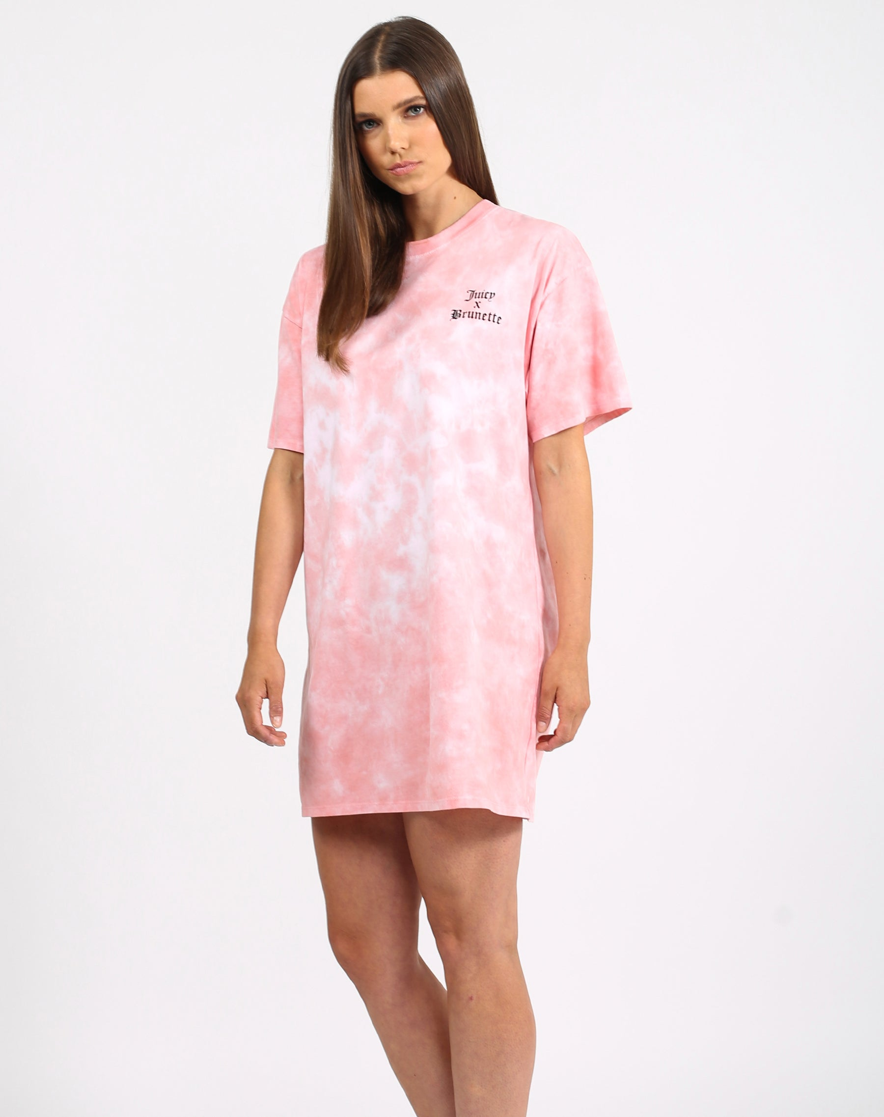 This is a photo of a model wearing the t-shirt dress  in pink marble by Brunette the Label x Juicy Couture.