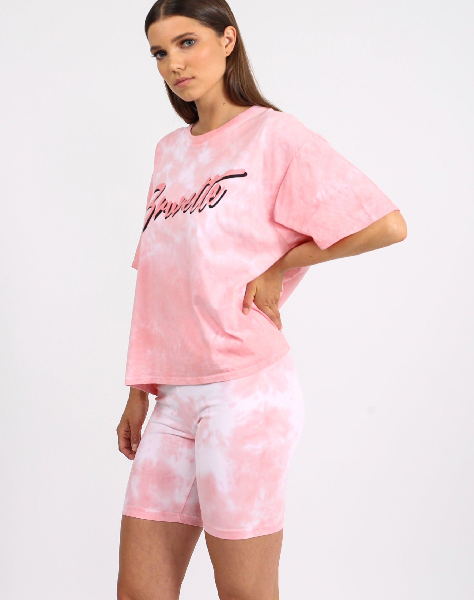 This is a photo of a model wearing the brunette boxy retro tee  in pink marble by Brunette the Label x Juicy Couture.