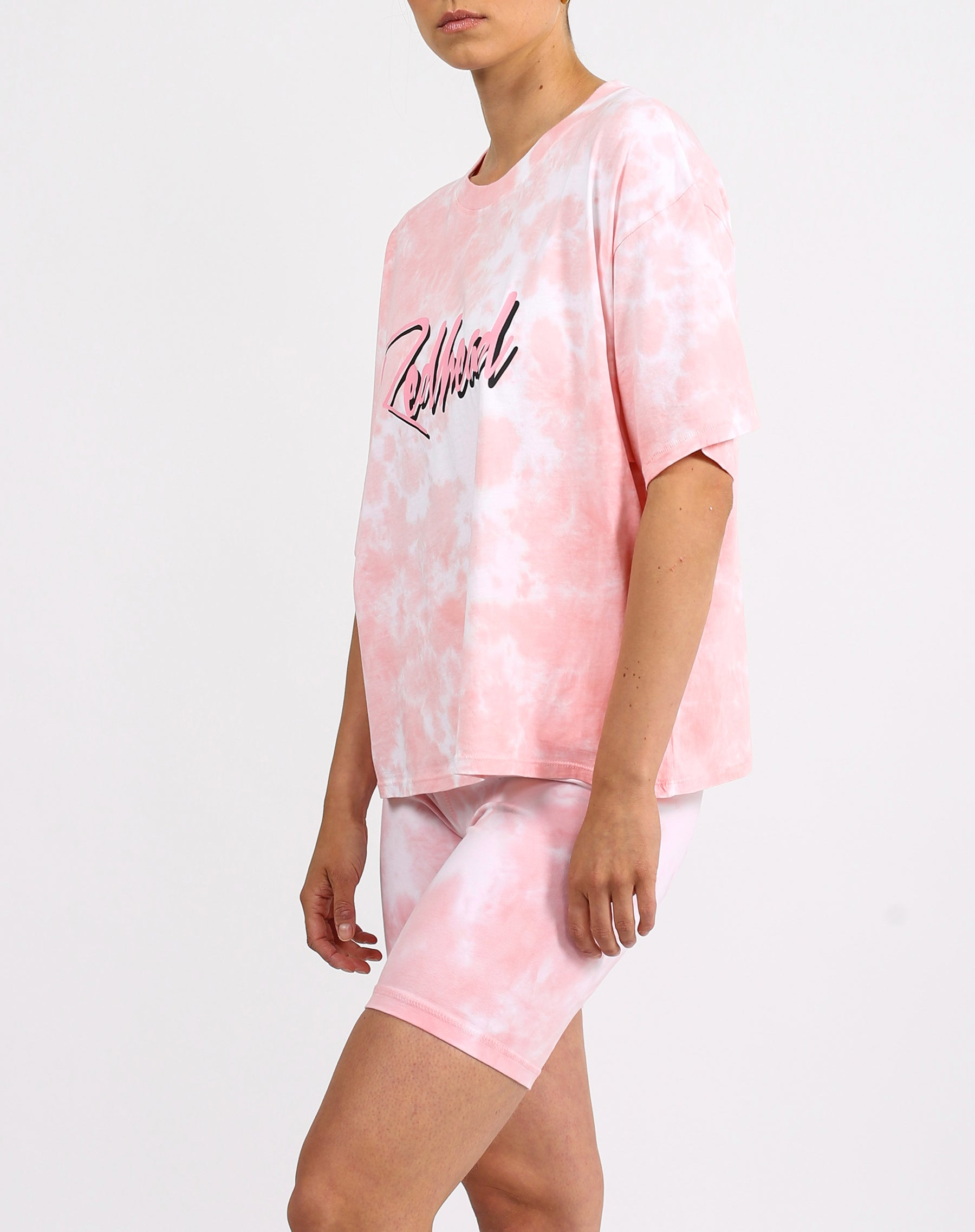 This is a photo of a model wearing the redhead boxy retro tee in pink marble by Brunette the Label x Juicy Couture.