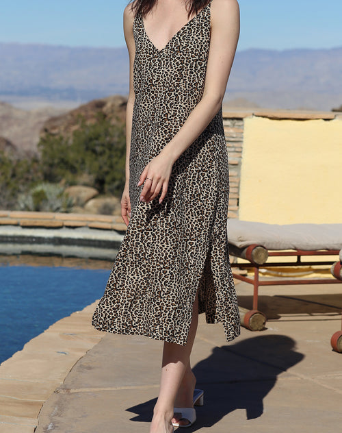 This is a campaign photo of the Koy resort beach babe dress in cheetah print by brunette the label.