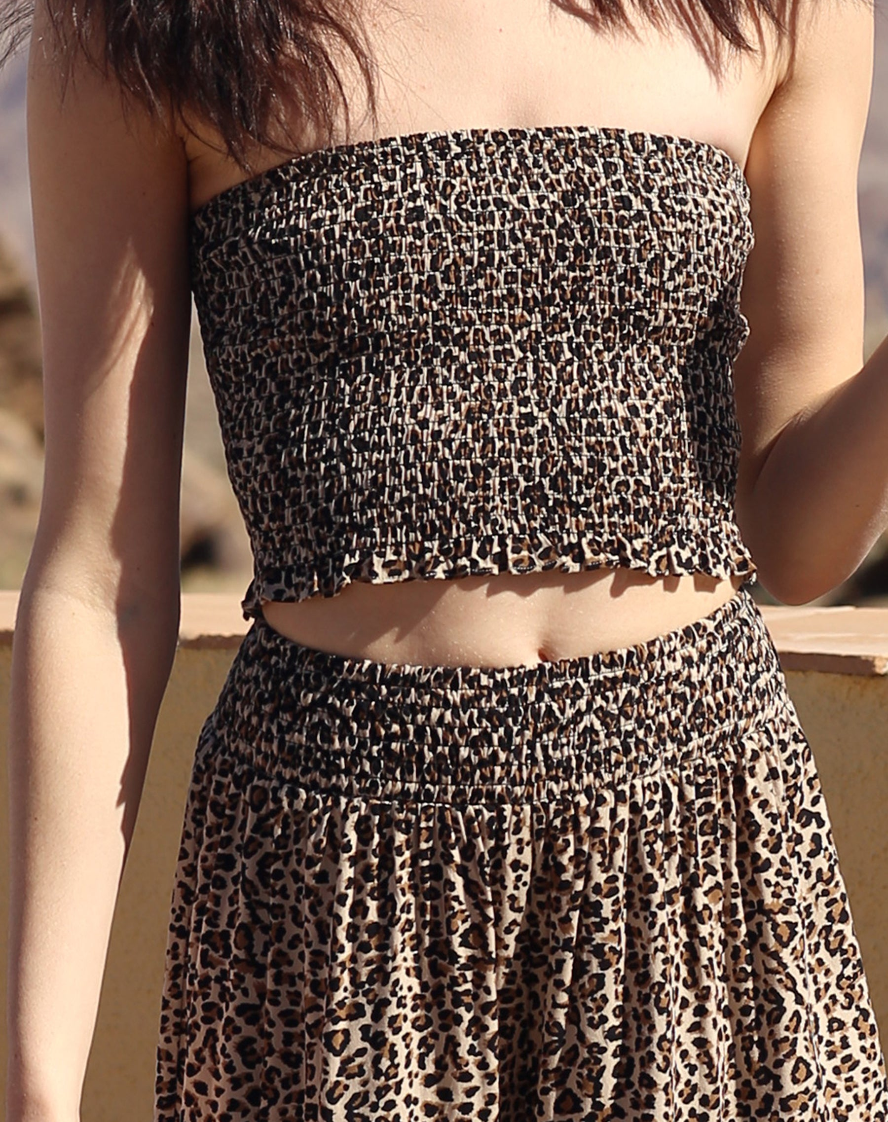 This is a campaign photo of the Koy resort beach babe tube top in cheetah print by brunette the label.