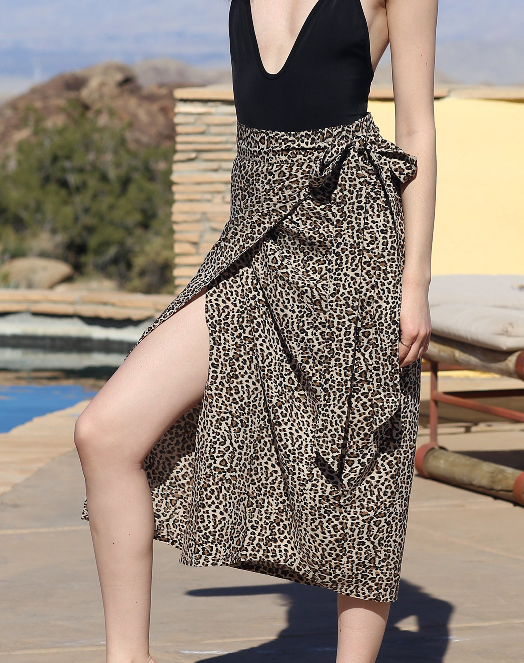 This is a campaign photo of the Koy resort beach babe wrap skirt in cheetah print by brunette the label.