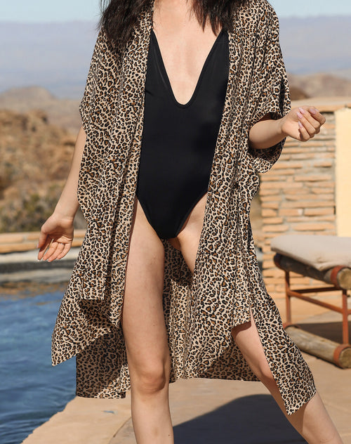This is a campaign photo of the Koy resort beach babe cover up in cheetah print by brunette the label.