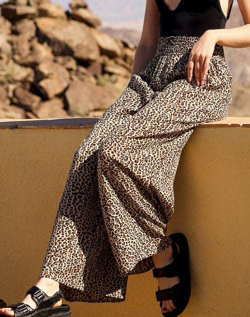 This is a campaign photo of the Koy resort beach babe pants in cheetah print by brunette the label.