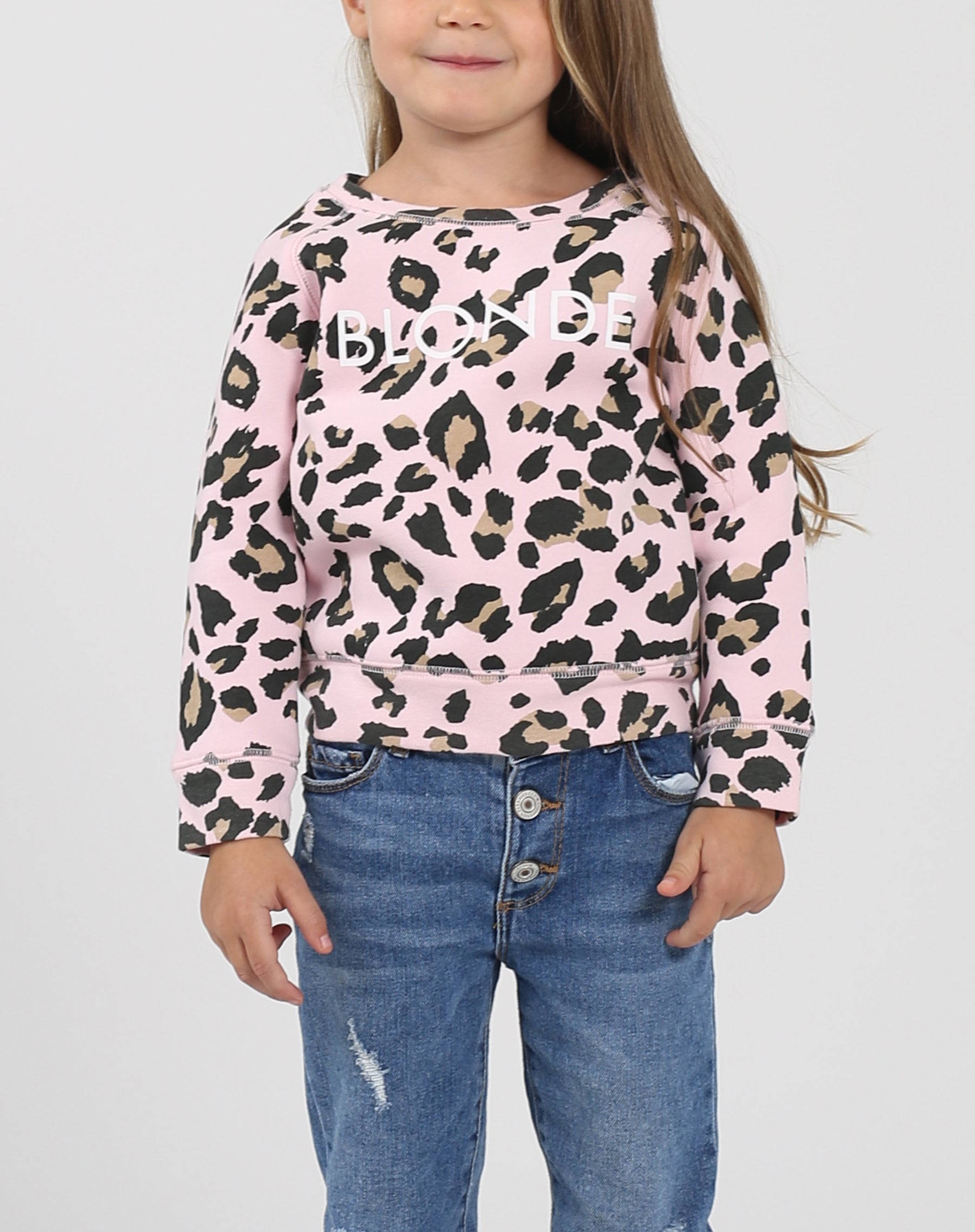 This is a photo of a model wearing the Little Babes Blonde Crew Neck Sweatshirt in Pink Leopard by Brunette The Label.