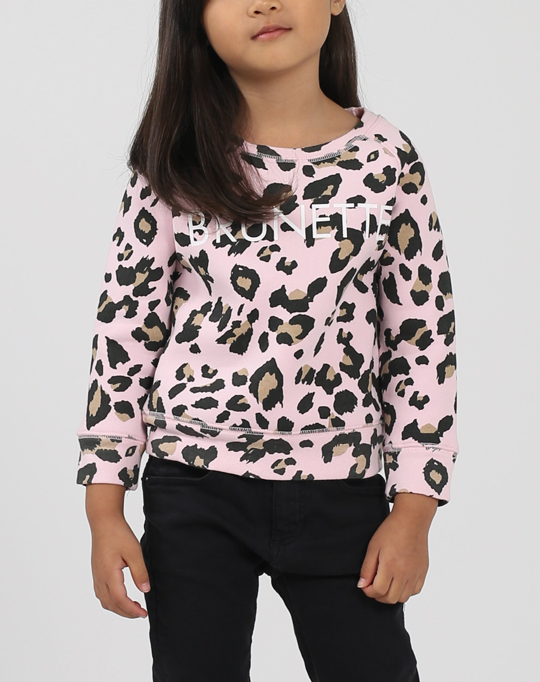 This is a photo of a model wearing the Little Babes Brunette Crew Neck Sweatshirt in Pink Leopard by Brunette The Label.