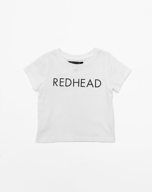 Photo of the Redhead Little Babes classic crew neck tee in black by Brunette the Label.