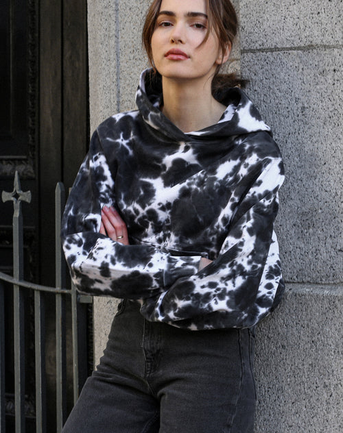 This is a photo of a model wearing the Marble Dye Best Friend Crew Neck Hoodie in Black By Brunette the Label.