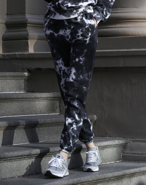 This is a photo of a model wearing the Marble Dye Best Friend Joggers in Black By Brunette the Label.