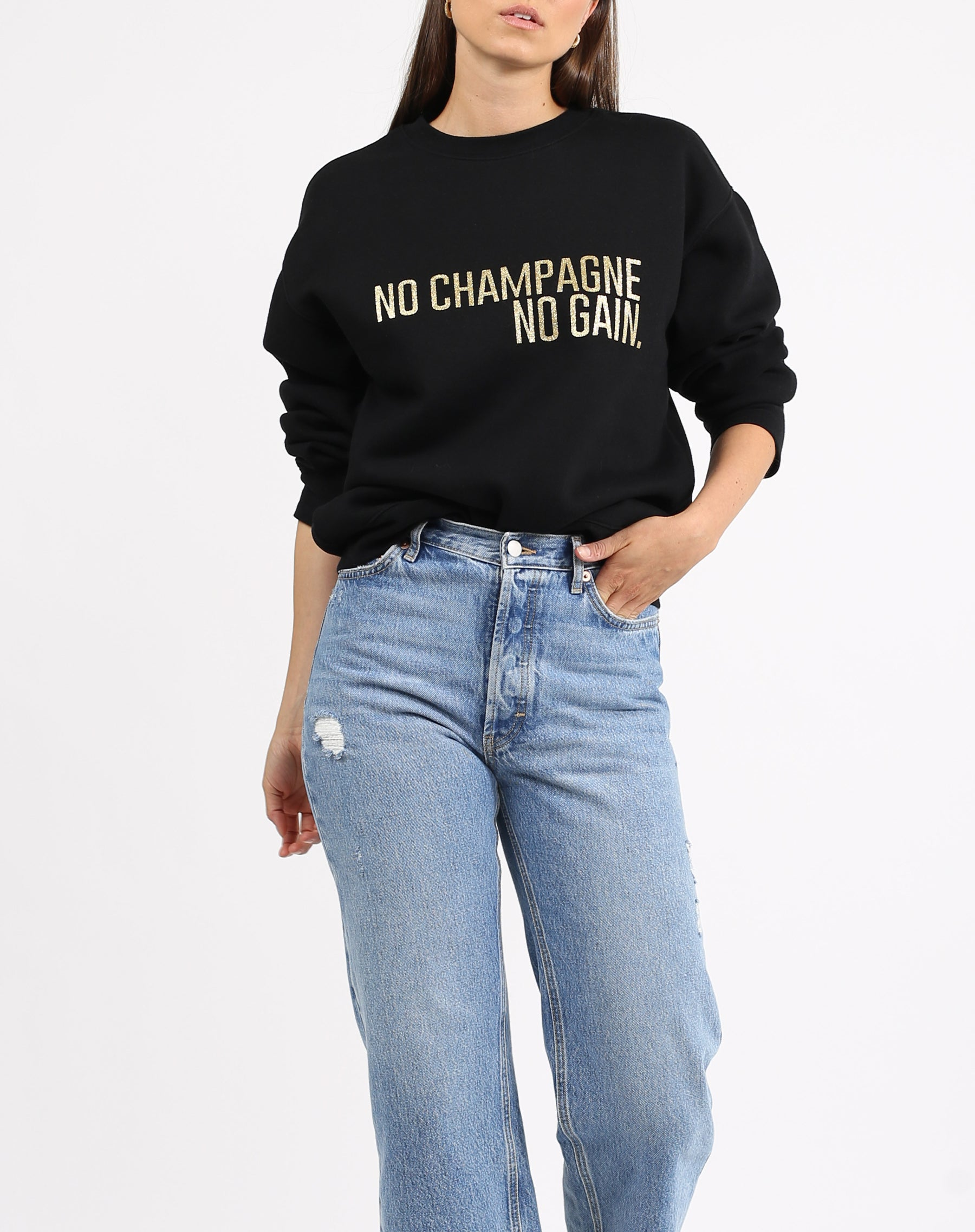 This is a photo of a model wearing the No Champgne Gold Glitter Classic Crew Neck Sweatshirt in Black by Brunette the Label.
