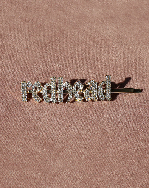 This is a photo of the Redhead Rhinestone Hair Clip in Gold by Brunette the Label.
