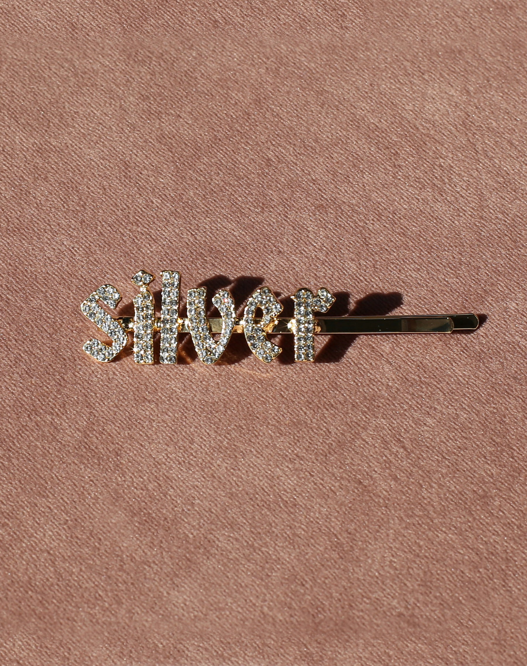 This is a photo of the Silver Rhinestone Hair Clip in Gold by Brunette the Label.